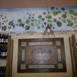 Decorazione con uva e finti mattoni
