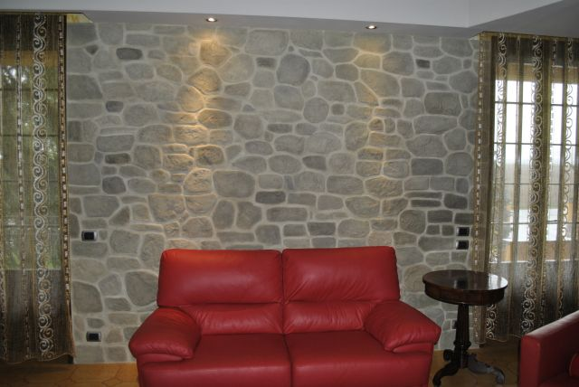 Finti mattoni sassi pietre - Parete rivestita in pietra ...